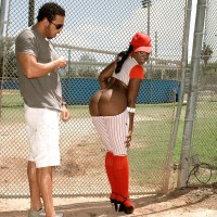 Ebony chick Kali Desires letting immense caboose loose from baseball uniform outdoors