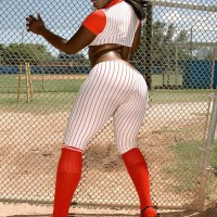 Black female Kali Cravings letting giant ass loose from baseball uniform outdoors
