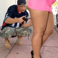 Black chick Sugary Louis showing off enormous rump outdoors clad micro miniskirt and high heeled shoes