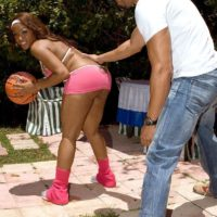 Ebony chick Ayana Angel flaunts her monster-sized buttocks in a short skirt while dribbling a basketball