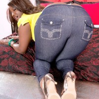 Ebony MILF Stacy Enjoy sports a whale tail while unleashing her enormous butt from denim jeans in high-heels