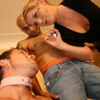 Blond gf Ashley Edmunds has her sub hubby lick another man's cock before she pummels him