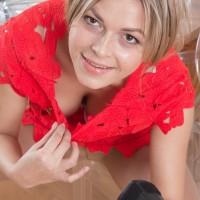 Ash-blonde amateur Ayda rolling hosiery down legs to unsheathe wooly vag