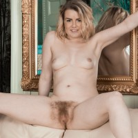 Yellow-haired first-timer Rebecca Louise baring small knockers from brassiere before opening up cooter