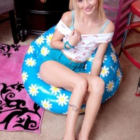 Platinum-blonde solo girl Sammy Daniels slipping cut-offs over ass and pins to expose panties
