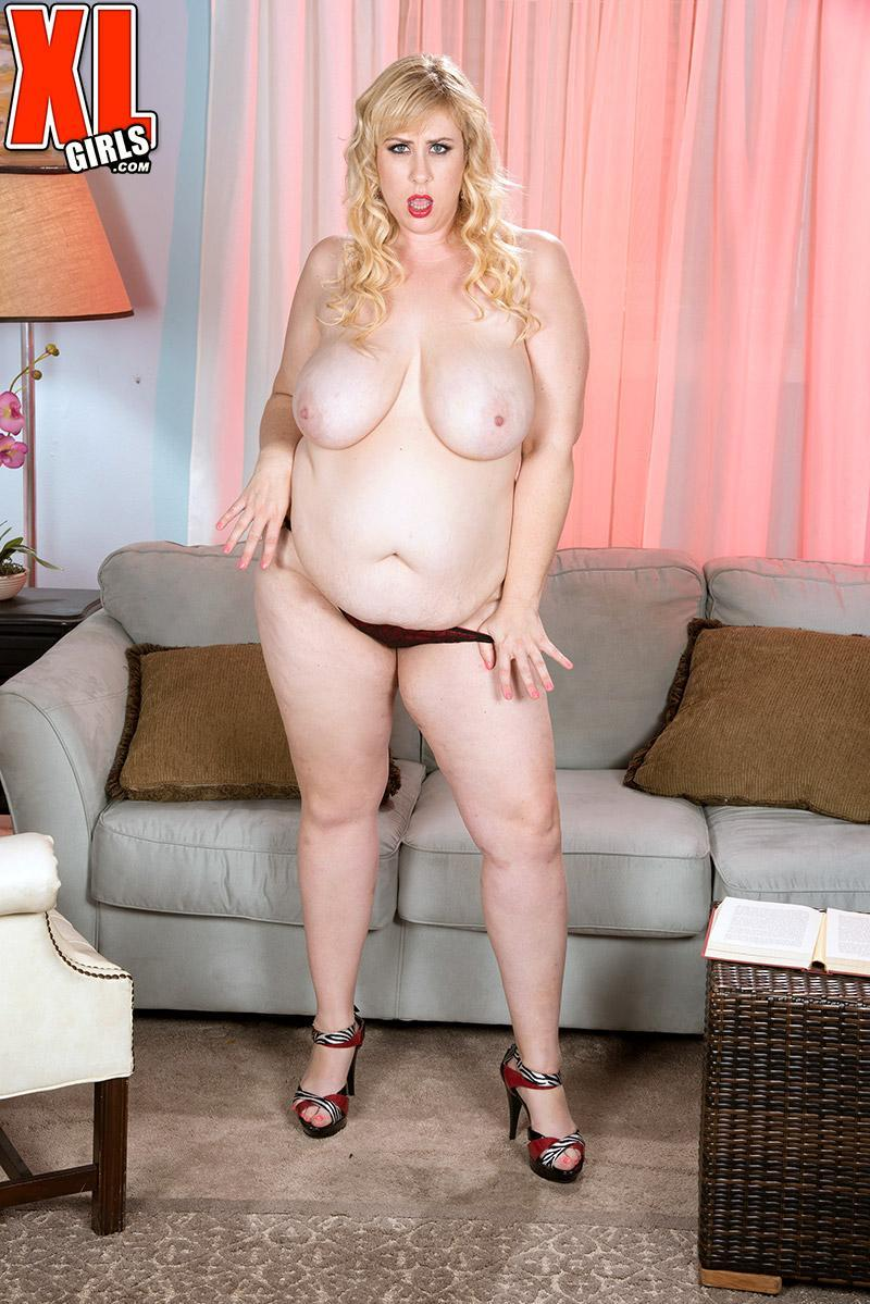 Blond BBW Lila Cute unsheathes her juggs as she does away with her sundress