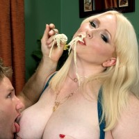 Sandy-haired BIG BEAUTIFUL WOMAN X-rated star Dawn Davenport jacking cock while tonguing food and masturbating