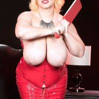 Fair-haired BIG SEXY LADY Samantha 38G bares hefty hooters from crimson latex sundress in high-heeled shoes