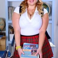 Blonde BIG SEXY WOMAN solo female Mya Blair posing in schoolgirl uniform, glasses and pigtails