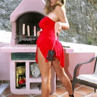 Yellow-haired European XXX vid star Ines Cudna revealing huge hooters from sundress outdoors