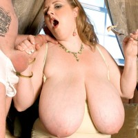 Blond feeder Sapphire unveiling enormous melons before providing handjob while tonguing