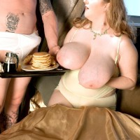 Blond feeder Sapphire letting out big titties before giving hand job while eating