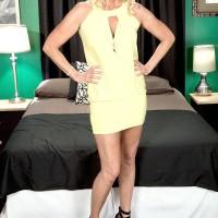 Blond grandma Nikki Chevious works on seducing a ebony guy in a yellow dress