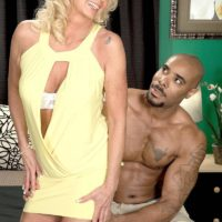 Blond grandma Nikki Chevious works on seducing a ebony guy in a yellow dress
