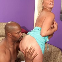 Sandy-haired granny Andi Roxxx tongue kisses a ebony dude before having her muff licked