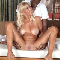 Sandy-haired grannie Brittney Snow gets seduced by her black rubdown therapist