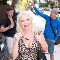 Platinum-blonde grandma Cammille Austin drains a pair of sausages after seducing studs in a dress
