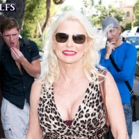 Blonde grannie Cammille Austin masturbates a pair of peckers after seducing boys in a sundress
