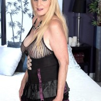 Blonde granny Charlie exposes her hefty tits in over the knee boots and mesh bodystocking