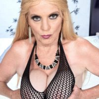 Yellow-haired grandma Charlie lets out her big funbags in over the knee boots and fishnet bodystocking