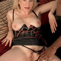 Platinum-blonde grandma Jennifer Janes has her titties and snatch unveiled by her black paramour