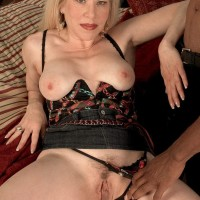 Blond granny Jennifer Janes has her boobs kneaded while being unclothed by a black guy