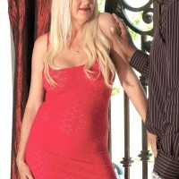 Blonde granny Marina Johnson greets her black lover in crimson sundress and matching high heels