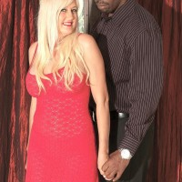 Fair-haired grandmother Marina Johnson has her first interracial sex experience in a red sundress