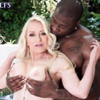 Yellow-haired grandmother Robin Pachino seduces a stud with a giant ebony penis outdoors
