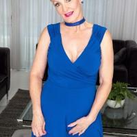 Platinum-blonde grannie with short hair Seka Ebony strips to tan stockings wearing a choker