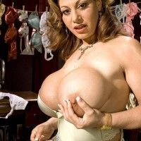 Ash-blonde MILF Crystal Gunns unveiling large breasts in tights and stilettos