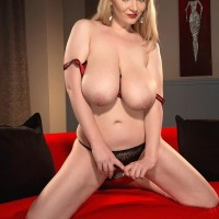 Yellow-haired MILF Micky Bells fellates on her own hard nips while holding her enormous boobs