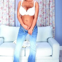 Platinum-blonde MILF adult flick star Autumn Jade uncovering humungous boobs while taking off jeans