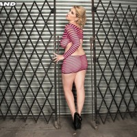 Sandy-haired MILF Rockell frees her giant natural boobs from a revealing dress in solo action