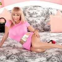 Platinum-blonde MILF Venera uncovering huge boobies adorned in high-heeled shoes on bed