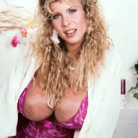 Light-haired MILF with excellent gams Lynden Johnson sets forth her giant fun bags in solo activity