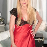 Platinum-blonde Nan Charlie seduces a junior guy in lingerie and ebony nylons