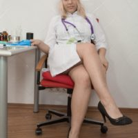 Golden-haired nurse Jill unzips in her office to showcase her furry coochie in high-heeled shoes