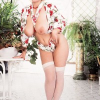Platinum-blonde solo chick Louise Leeds flaunts her big melons and thicket in white stockings