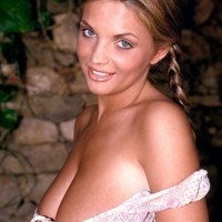 Blond solo model Ines Cudna extracts her hefty knockers with hair up in braids