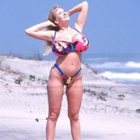 Blond solo model Kayla Kleevage looses her fake boobs from a bikini while at the beach