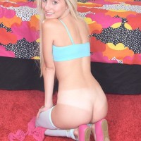 Sandy-haired teen Naomi Forest takes off her micro-skirt and pulls down her milky hosiery