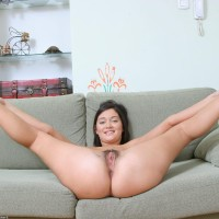 Brown-haired amateur with a sexy backside and petite titties looses her all-natural coochie on a chesterfield