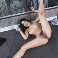 Dark-haired first timer with monster-sized all natural nubile melons and stunning gams parting wooly cooter