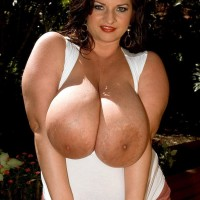 Brown-haired solo girl Maria Moore baring massive juggs outdoors in cut-offs