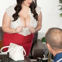 Dark haired BIG SEXY WOMAN Angel DeLuca having her massive boobies revealed while getting undressed au naturel