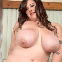 Dark haired BBW Angel Sin sucks on a sex toy and swell nips after doffing wonderful lingerie