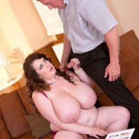 Dark haired BBW Anna Beck unsheathing monster-sized funbags before giving BLOWJOB and fucking on sofa