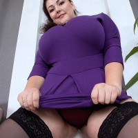 Brown-haired BIG SEXY LADY Mariya Mills letting gigantic saggy boobies free from sundress and brassiere in stockings