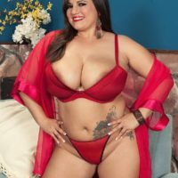 Brunette big beautiful woman Melonie Max tit strangling dude with immense fun bags in red lingerie